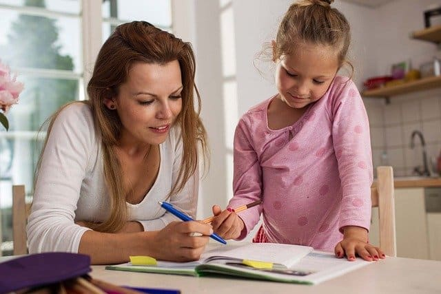Mom and child writing together