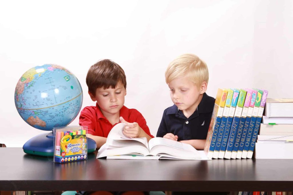 Two Boys Reading at Desk